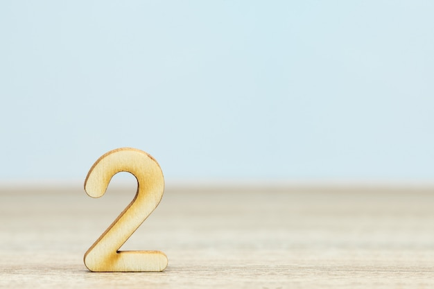Close up wooden numeric on table with copy space, number two
