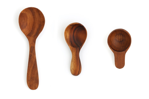 Close up wooden spoon set isolated on white surface
