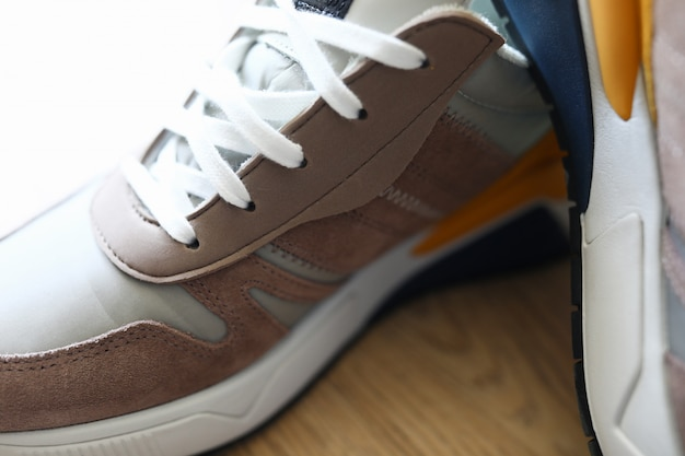 Close-up on a wooden surface are mens sneakers