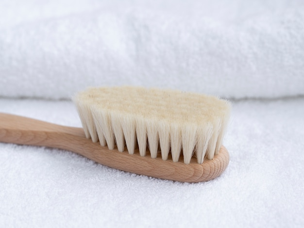 Close-up wooden toothbrush with towels