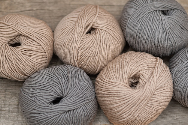 Close up of wool knitting on wooden background