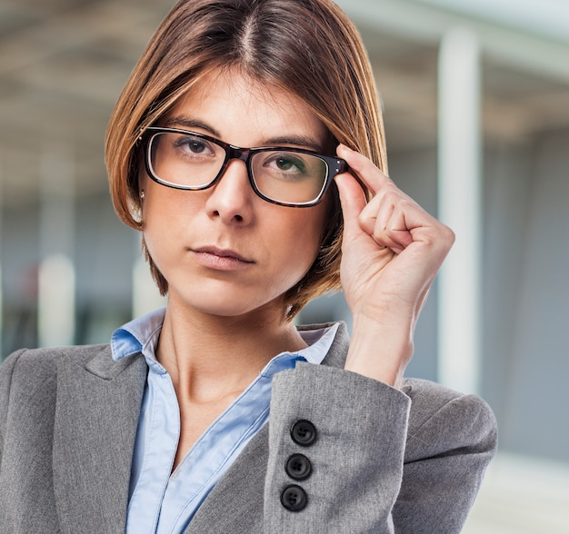 Close-up of worker with black glasses and short hair