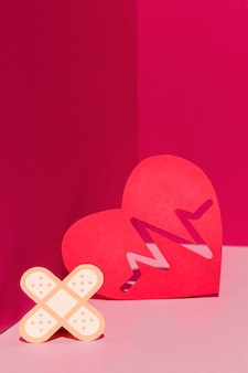 Close-up world heart day concept with band aid
