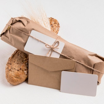 Close-up wrapped bread with envelope with wheat