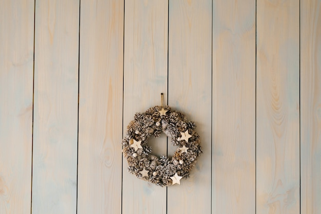 Close-up of wreath hanging from wall