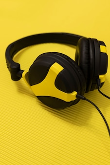 Close-up of yellow and black headphones.