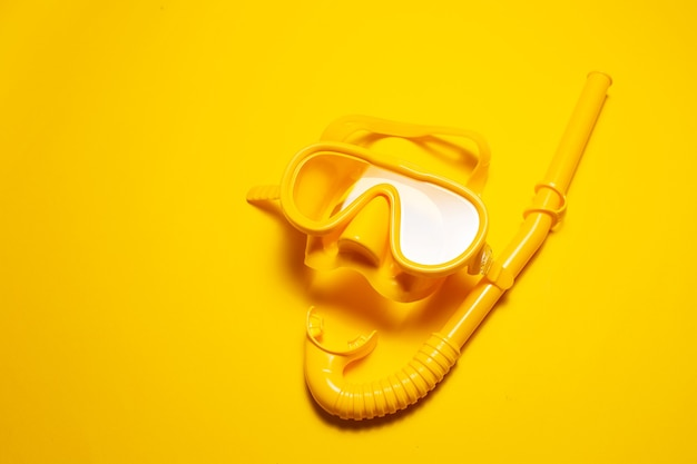 Close-up of yellow diving mask with snorkel,