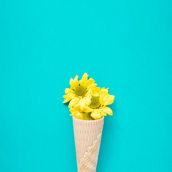 Close-up yellow flowers in waffle cone