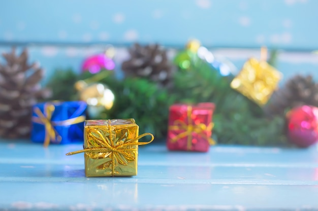 Close up of yellow gift box for christmas or new year decoration background