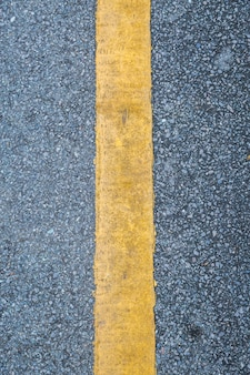 Close up of yellow line  on the road background