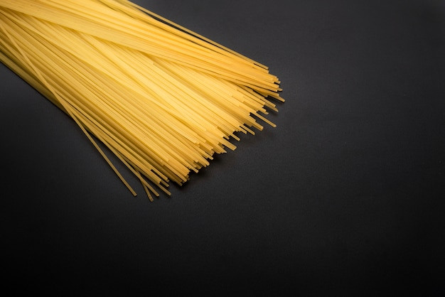 Close-up of yellow long spaghetti pasta on kitchen worktop