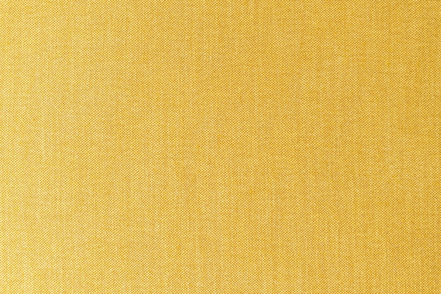 Текстура поверхности ткани желтой или золотой горчицы крупным планом для фона