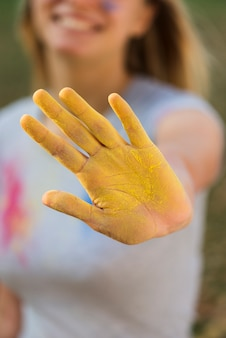 Close-up of yellow powdered hand