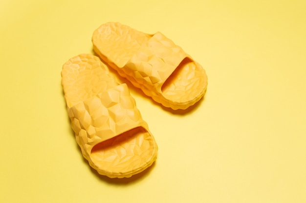 Close-up of yellow slippers