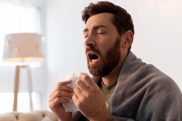 Close up on young adult sick at home