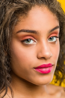 Close up of a young african american beautiful and make-up woman posing