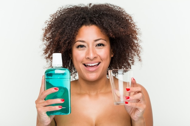 Close up of a young african american woman holding a mouthwash