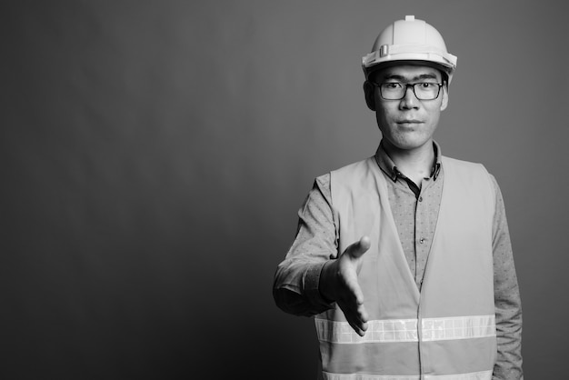 Close up of young asian man construction worker wearing eyeglasses