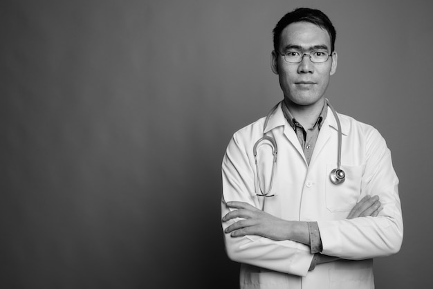 Close up of young asian man doctor wearing eyeglasses