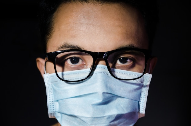 Close up of young asian man wearing hygienic mask