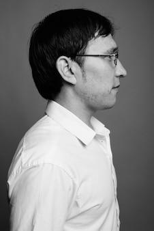 Close up of young asian nerd man wearing eyeglasses