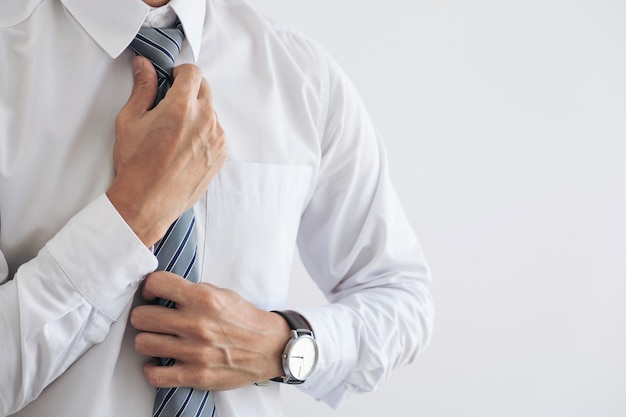 Close up of young attractive businessman wears a gray tie