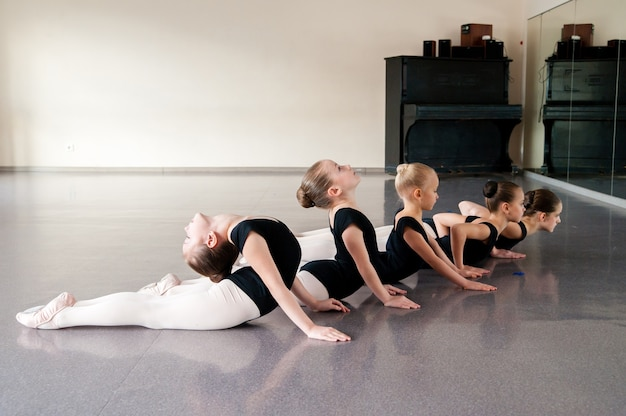 Close up on young ballerinas practicing in the studio
