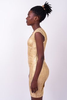 Close up of young beautiful african woman wearing gold dress ready to party isolated