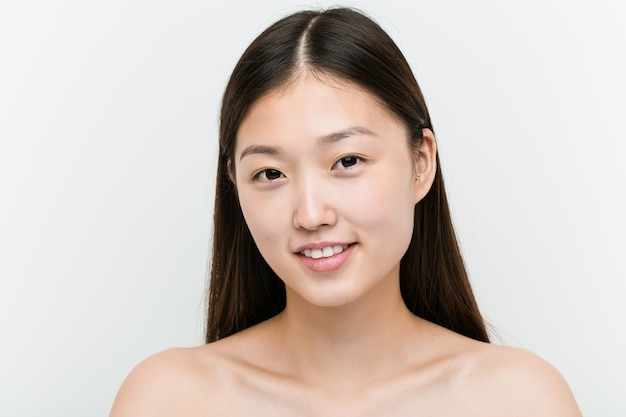 Close up of a young beautiful and natural asian woman