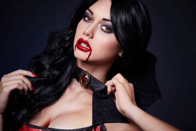 Close up on young beautiful woman dressed for halloween