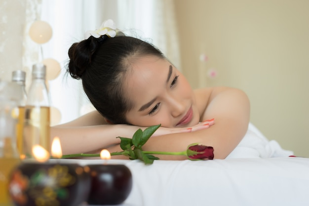 Close up of young beautiful woman relaxing during spa treatment.