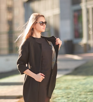 Close up. young business woman standing on the street . business people