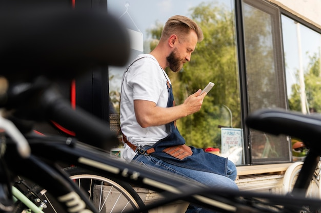 Close up on young businessman in bike shop