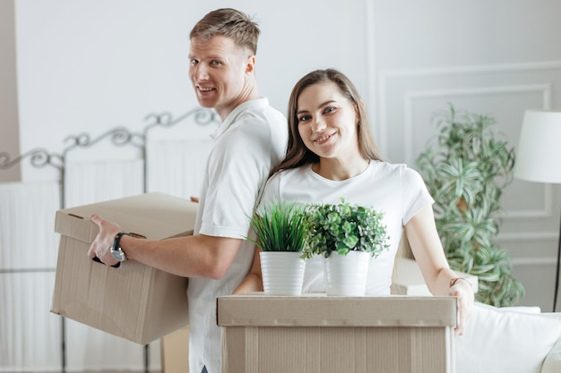 Close up young couple arranging boxes in their new apartment