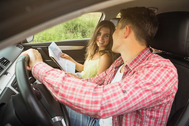 Close-up of young couple enjoying travelling in car