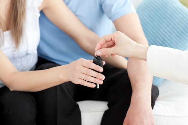 Close-up of a young couple receiving their new car's key
