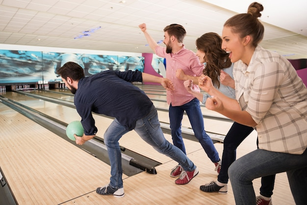 Close up on young friends enjoying bowling