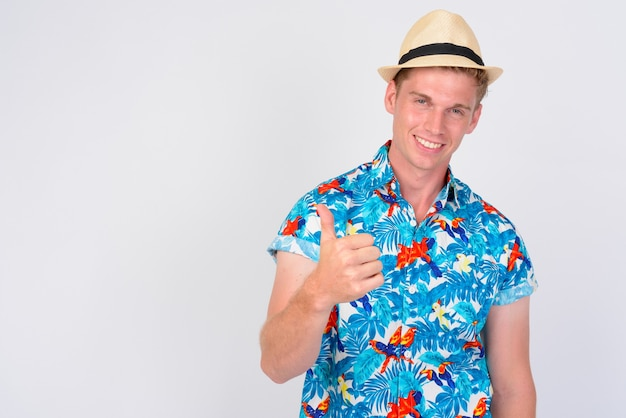 Close up of young handsome tourist man with blond hair isolated