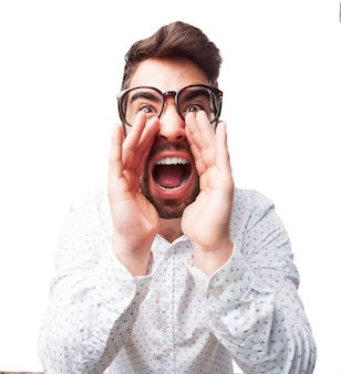 Close-up of young man with glasses screaming