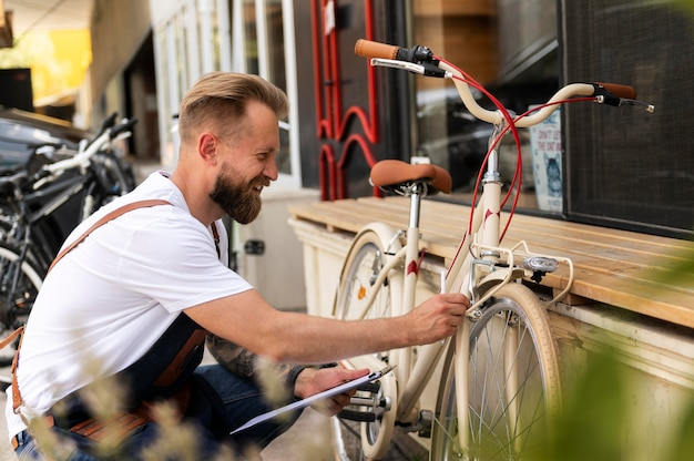 Close up on young man working on a bike
