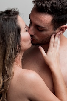 Close-up young naked couple kissing