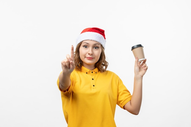 Close up on young pretty woman wearing christmas hat isolated