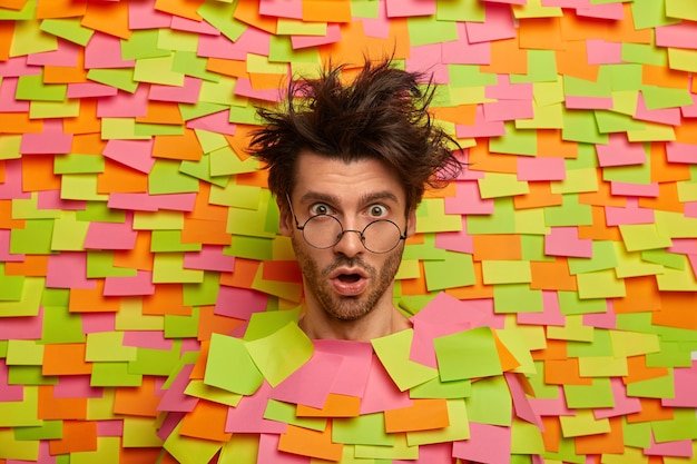 Close up on young student surrounded by sticky notes