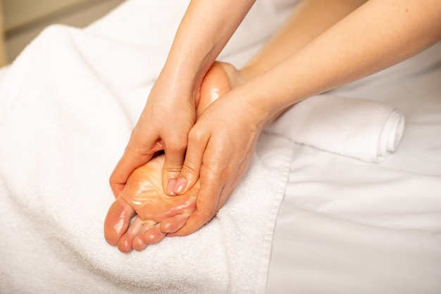 Close-up of young woman having foot massage