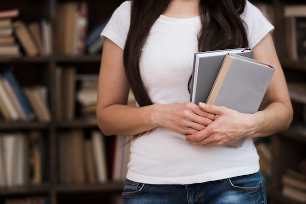 Close-up young woman holding novel books