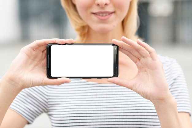 Close-up young woman holding a phone