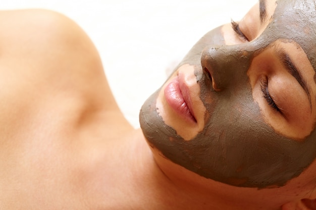 Close-up of young woman purifying the facial skin