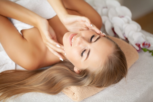 Close-up of a young woman receiving spa treatment