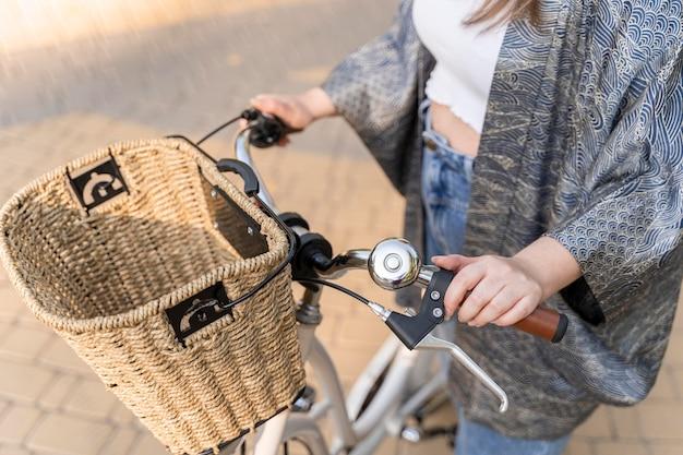 Close-up young woman riding bike