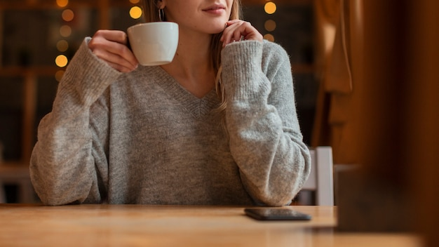 Close-up young woman with coffee